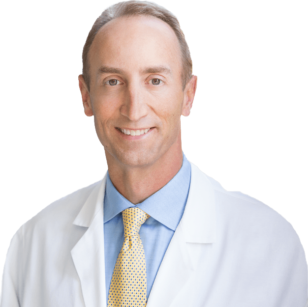 Dr. David Kaufman in white coat